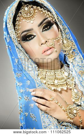 Beautiful traditional indian bride portrait in bollywood style portrait