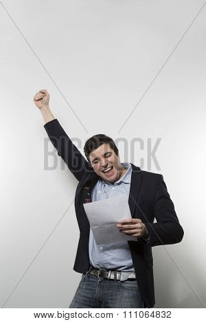 studio shot of happy businessman celebrating a paper