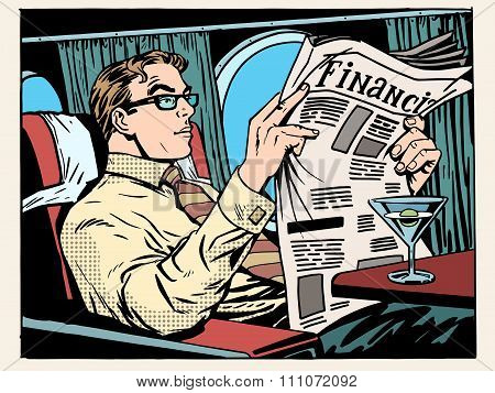 Business class plane businessman reads the press