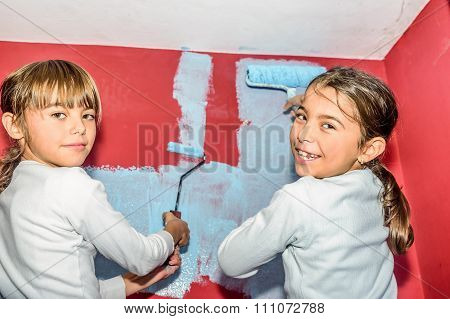 Eight Year Old Twins Girls Painting The Wall At Home