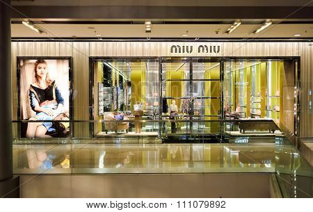 HONG KONG - MAY 5, 2015: Miu Miu store in the the IFC Mall. Miu Miu is a high fashion women's clothing and accessory brand from the Prada fashion house
