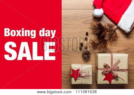 Beautiful presents Boxing Day sale concept desk with santa hat view from above