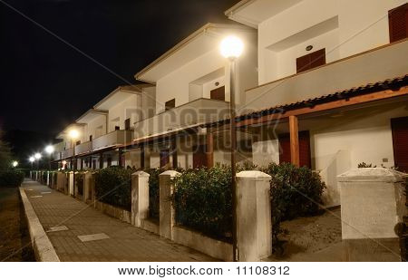 View Of Building Of Sanatorium At Night. Two-storey Villas With Private Balconies