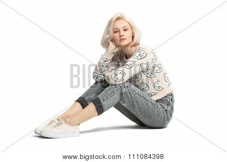Fashion Female Model Sitting On Floor Isolated On White Bakckground