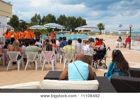 Calabria - Jule 26: Tourists Sit On In Courtyard Of Sanatorium And Watch Concert