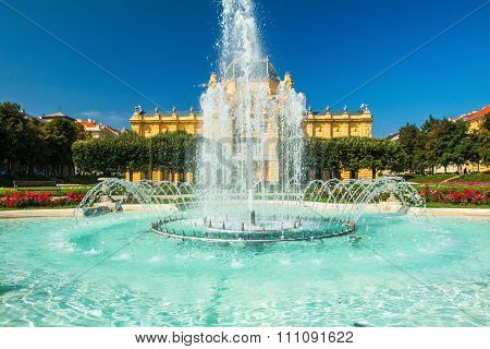 Fountain in front of art pavilion in Zagreb, capital of Croatia, blue sky, summer day