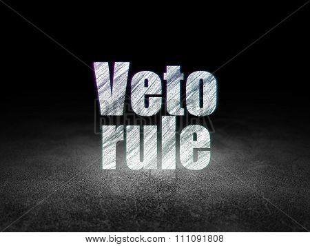Political concept: Glowing text Veto Rule in grunge dark room with Dirty Floor, black background poster