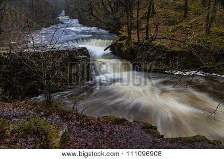 Sgwd y Bedol Falls waterfall. Pontneddfechan Vale of Neath Powys Wales United Kingdom winter. poster