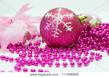 Red Christmas Ball And Other Pink Christmas-tree Decorations