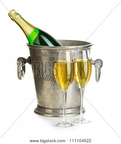 Champagne Bottle In Ice Bucket With Glasses Of Champagne Close-up Isolated On A White Background. Fe