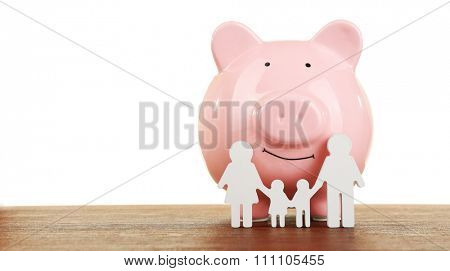 Pig money box and paper decor on a table isolated on white