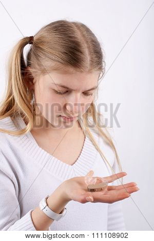 Girl Holding A Hearing Aid