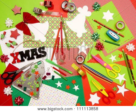 Red and green color paper pencils different washi tapes craft scissors cardboard cuts festive xmas supplies for decoration. poster