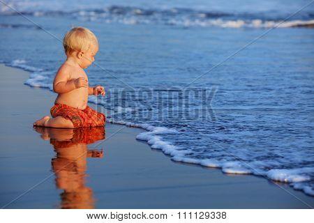 Little Child Has A Fun On Black Sand Sunset Sea Beach