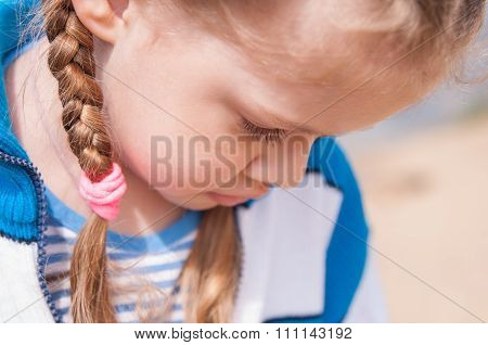 Upset Girl Turns Away And Hides Her Face