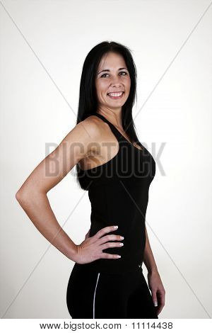 Healthy woman standing with hands on hips