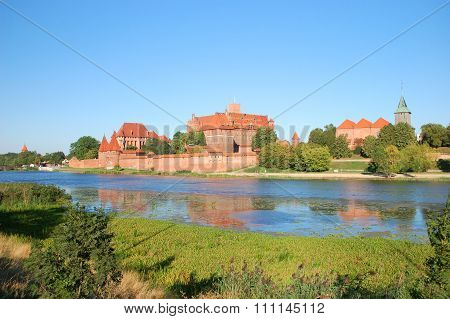 Picturesque scene of Malbork castle on Nogat river in Poland poster