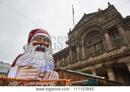 BIRMINGHAM, UK - DECEMBER 03: Santa Claus statue in Victoria Square with the Museum of Arts facade in the background. The statue was part of the Christmas market. December 03, 2015 in Birmingham.