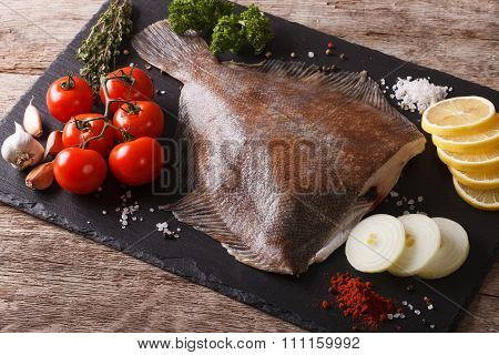 Fresh Raw Plaice With Ingredients On A Slate Board. Horizontal