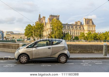 PARIS, FRANCE - CIRCA AUGUST 2015: An Autolib' is parked at an Autolib' station and charging point. Autolib' is an electric car sharing service.