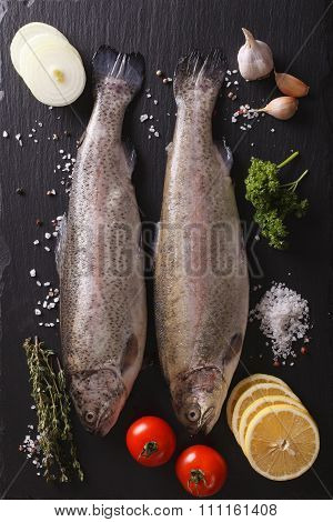 Raw Trout With Ingredients On A Slate Board Closeup. Vertical Top View