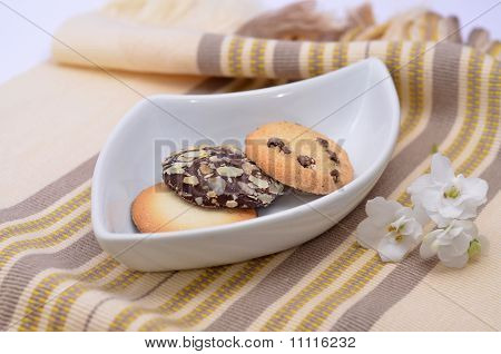 Delicious Cookies And Biscuits On White Plate With Flower