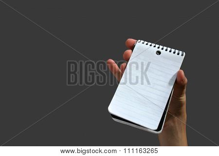 Isolated hand holding empty notepad