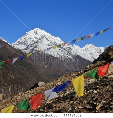 Prayer Flags And Snow Capped Mountain In The Himalayas