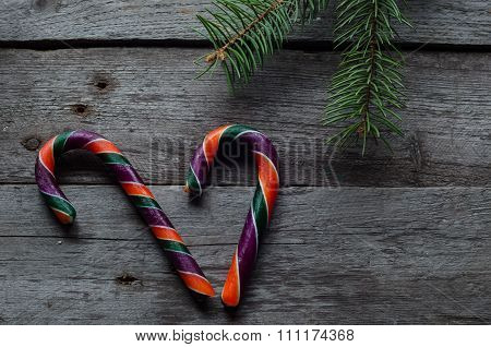candy canes on a wooden background.