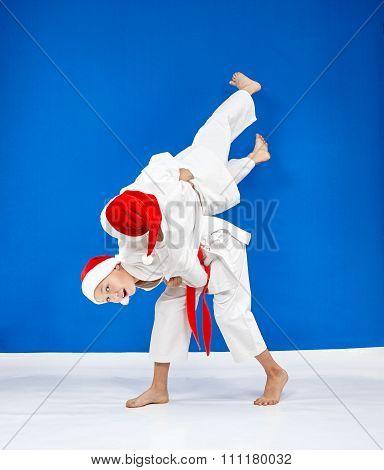 Throws Judo the athletes are train in caps of Santa Claus