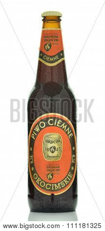Okocim dark beer isolated on white background