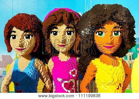 Moscow, Russia - December 11, 2015: Three Girls Made By Lego Blocks In Central Children's Store On L