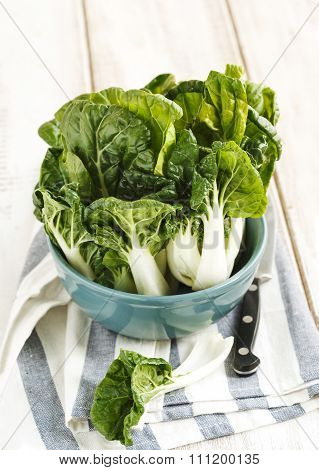 Bok Choy In Bowl On A Wooden Table