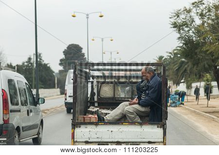 One Man Sits In The Truck And Plays Mobile Phone