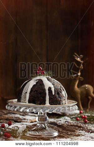 Christmas pudding and poured cream with creative lighting