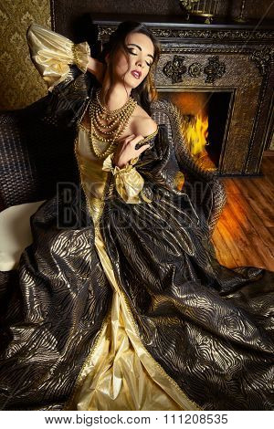 Renaissance Style -  beautiful young woman in the lush expensive dress in an old palace interior. Vintage style. Fashion.