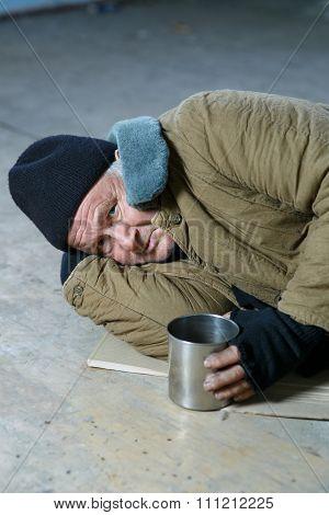 Homeless man lying on the floor.