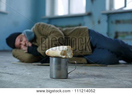Homeless man sleeping on the cardboard.