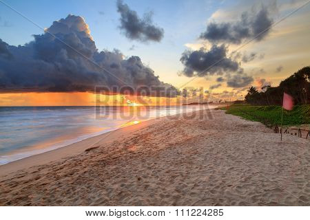 Sea  And Beach With Dark Rain Clouds At Sunset