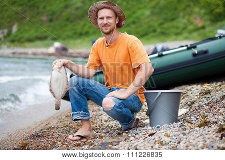 Fisherman With Flatfish In His Hand