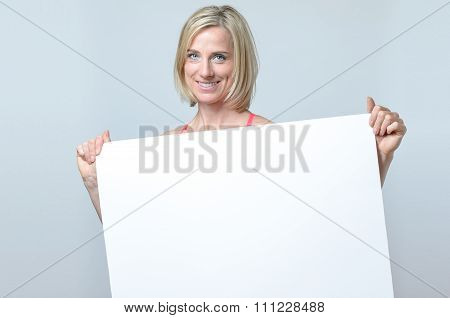 Attractive Blond Woman Holding A Blank Sign