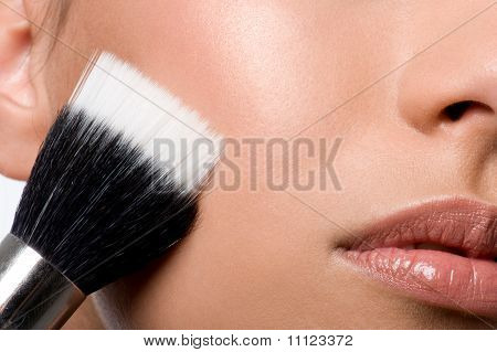 Woman Applying Rough On Cheek
