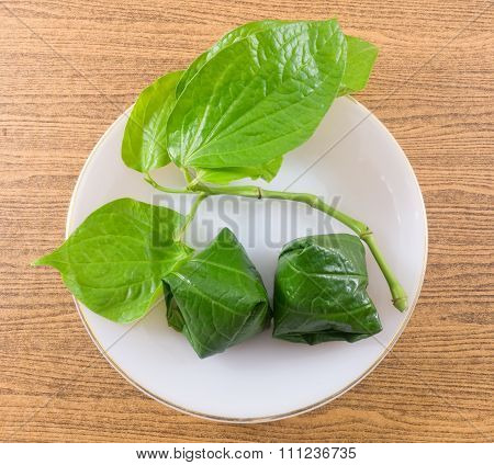 Top View Of Betel Leaf Wrapped Bite Size Appetizer