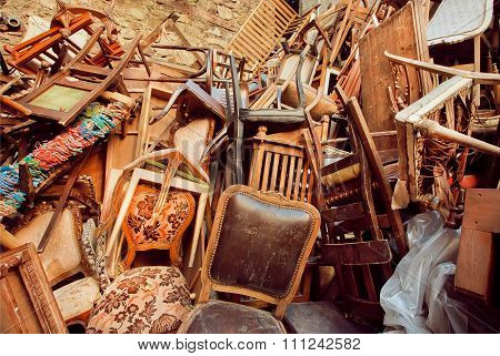 Abandoned Store With Old Wooden Chairs, One On The Other