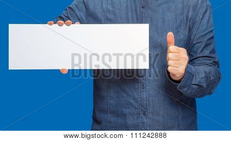 Man Holding A Sign