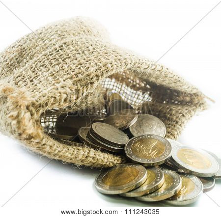 Thai Baht Coins In A Small Sack On A White Background