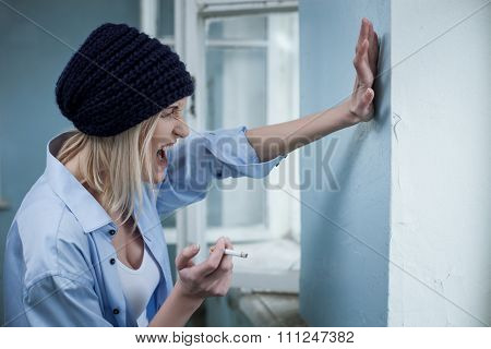 Depressed female drug addict is expressing negative feelings