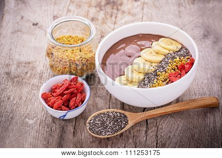 bowl of breakfast with chocolate banana smoothies garnished