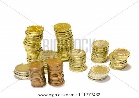Towers Of Coins Of Euro Isolated