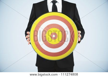 Bull's-eye Concept With Businessman Holds A Dart